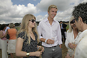 Arabella tobias and James Cook, Veuve Clicquot Gold Cup 2006. Final day. 23 July 2006. ONE TIME USE ONLY - DO NOT ARCHIVE  © Copyright Photograph by Dafydd Jones 66 Stockwell Park Rd. London SW9 0DA Tel 020 7733 0108 www.dafjones.com