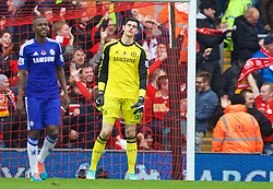 LIVERPOOL, ENGLAND - Saturday, November 8, 2014: Chelsea's goalkeeper Thibaut Courtois looks dejected as Liverpool score the opening goal during the Premier League match at Anfield. (Pic by David Rawcliffe/Propaganda)