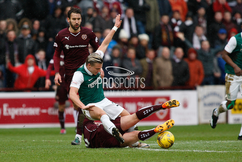 Hibernian FC Forward Jason Cummings getting tripped during the Scottish Cup 5th round match between Heart of Midlothian and Hibernian at Tynecastle Stadium, Gorgie, Scotland on 7 February 2016. Photo by Craig McAllister.