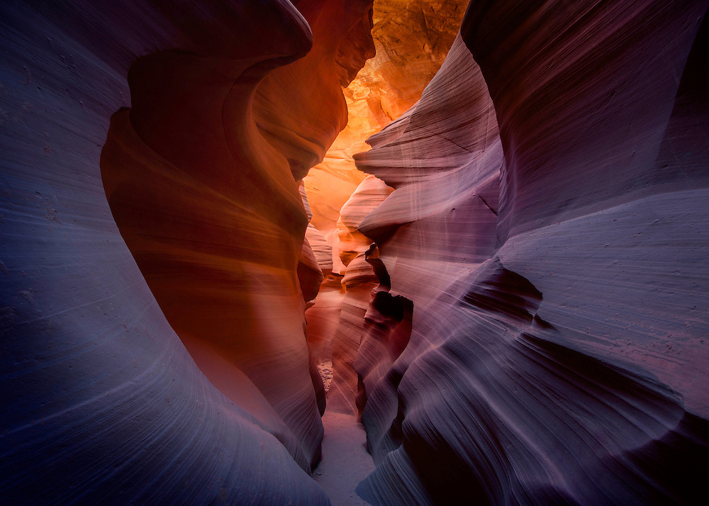 A sandstone canyon is sculpted from the desert floor by periodic flash floods, Antelope Canyon, USA.