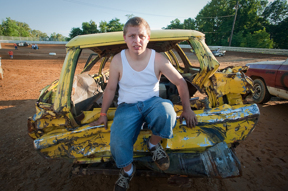 Boy with his vehicle at a Demolition Derby