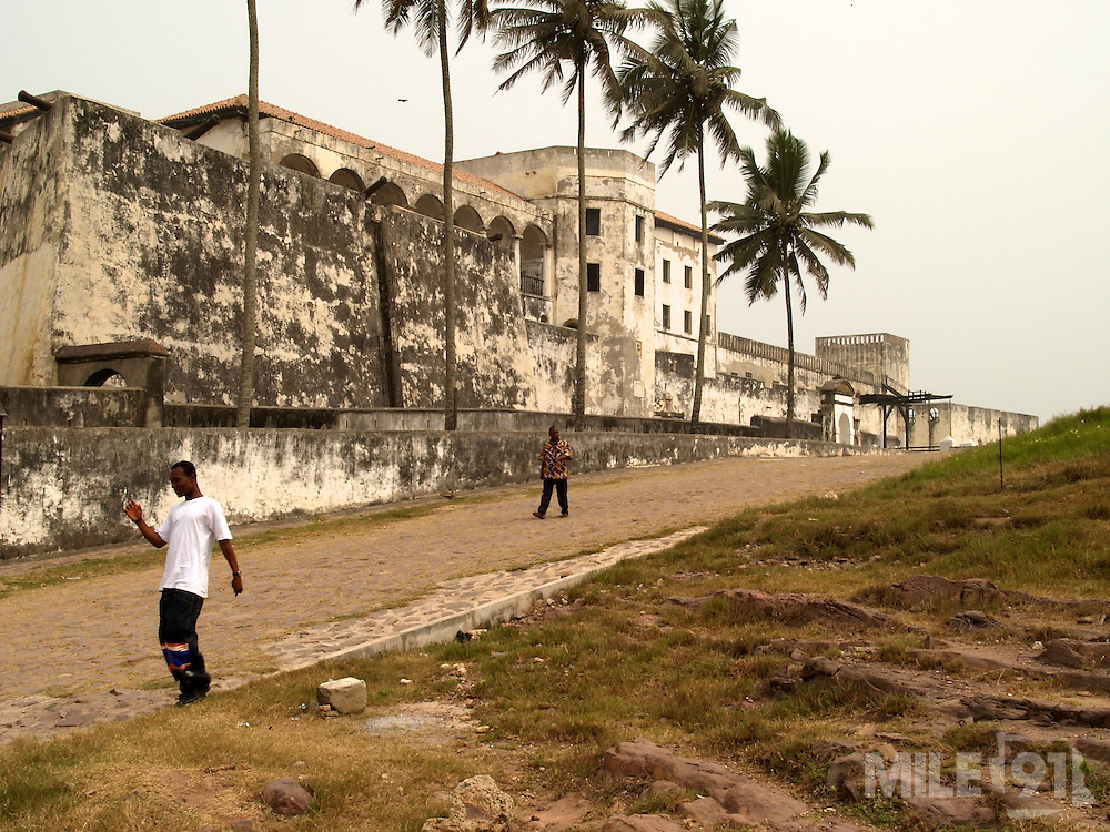 Elmina Castle in Ghana. Elmina castle was erected by Portugal in 1482. The castle later became one of the most important stops on the route of the Atlantic slave trade.