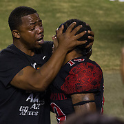 10 September 2016: The San Diego State Aztecs football team hosts Cal in their second game of the season. Done Pumphrey Senior celebrates with his son after he broke Marshall Faulks all time rushing record at San Diego State. The Aztecs beat Cal 45-40 to keep their win streak at 12 games going back to last season and improve their record to 2-0.