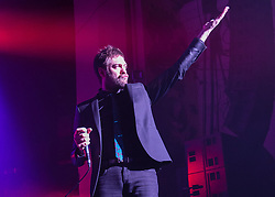 © Licensed to London News Pictures. 01/12/2014. London, UK.   Kasabian performing live at Brixton Academy for the first of five consecutive nights at the venue.   In this picture - Tom Meighan.  Kasabian consists of members Tom Meighan (lead vocals) Sergio Pizzorno (guitar, backing vocals), Chris Edwards (bass), Ian Matthews (drums).  Photo credit : Richard Isaac/LNP