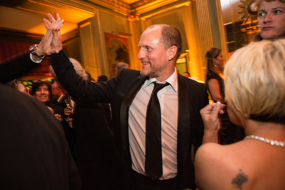 Actor Woody Harrelson gives a high five at the Bloomberg Vanity Fair White House Correspondents' Association dinner afterparty at the residence of the French Ambassador on Saturday, April 28, 2012 in Washington, DC. Brendan Hoffman for the New York Times