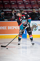 KELOWNA, CANADA - SEPTEMBER 28:   Madison Bowey #4 of the Kelowna Rockets makes a pass against the Victoria Royals at the Kelowna Rockets on September 28, 2013 at Prospera Place in Kelowna, British Columbia, Canada (Photo by Marissa Baecker/Shoot the Breeze) *** Local Caption ***