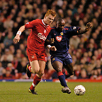 Photo. Jed Wee.Digitalsport<br /> Liverpool v Portsmouth, FA Barclaycard Premiership, Anfield, Liverpool. 17/03/2004.<br /> Liverpool's John Arne Riise (L) tries to keep Portsmouth's Lomana Lua Lua in check.