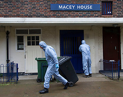 Greenwich. Police forensic officers removing evidence from a flat in Greenwich believed to be the home of one of the Woolwich terror suspects, Michael Adeboyale, London, UK, May 24, 2013. Photo by:  i-Images