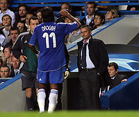 Photo: Paul Thomas.<br /> Chelsea v Barcelona. UEFA Champions League, Group A. 18/10/2006.<br /> <br /> Jose Mourinho (R), Chelsea manager, looks at an injured Didier Drogba.