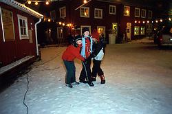 SWEDEN FJALLBACKA JAN04 - Children dance on the snow during New Year's Eve.. . jre/Photo by Jiri Rezac. . © Jiri Rezac 2004. . Contact: +44 (0) 7050 110 417. Mobile:  +44 (0) 7801 337 683. Office:  +44 (0) 20 8968 9635. . Email:   jiri@jirirezac.com. Web:    www.jirirezac.com.