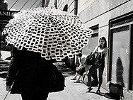 Man with an umbrella made entirely out of Kodachrome slides, seen on West 34th Street in New York City
