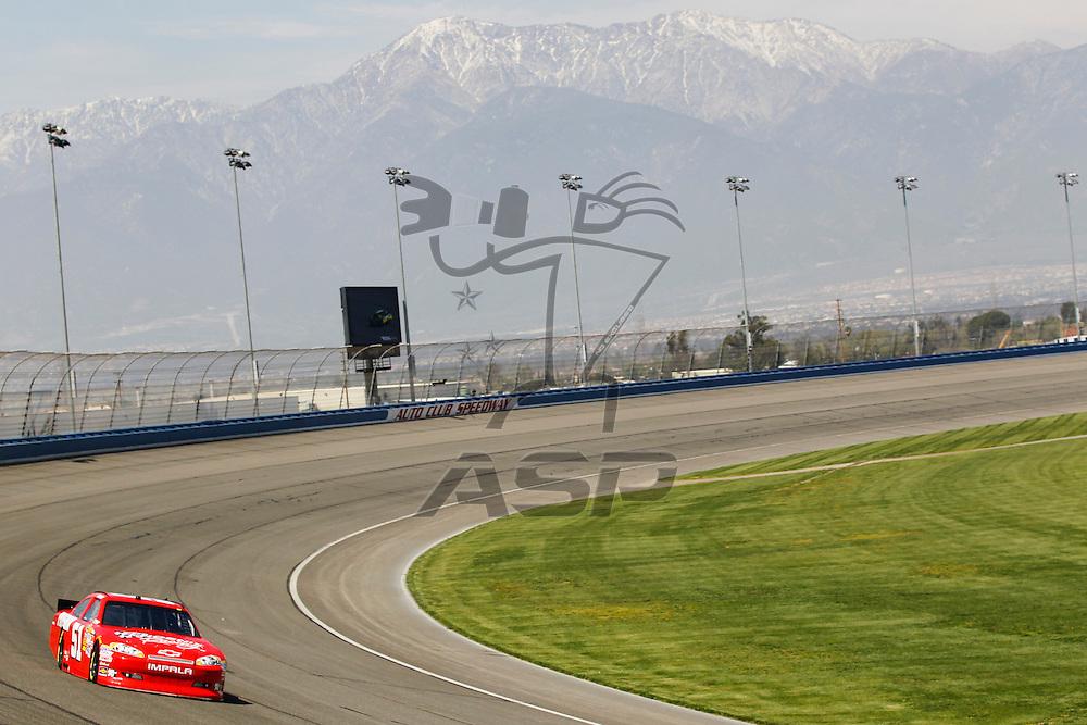 FONTANA, CA - MAR 23, 2012:  Kurt Busch (51) brings his car through turn 4 during the Auto Club 400 at the Auto Club Speedway in Fontana, CA.