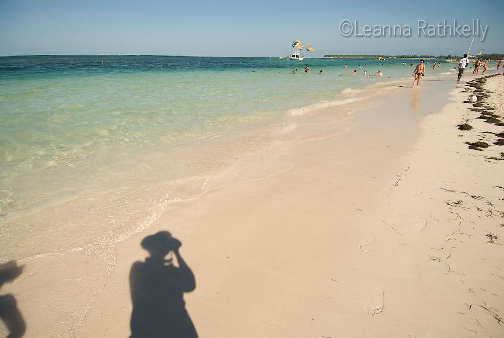 Shadows of us on the white sand of Bavaro Beach, near Punta Cana, Dominican Republic.