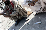"Addicts inject doses of heroin hid from the local people on a roof top of a building. Morgh Mandi, Rawalpindi, Pakistan, on friday, November 28 2008.....""Pakistan is one of the countries hardest hits by the narcotics abuse into the world, during the last years it is facing a dramatic crisis as it regards the heroin consumption. The Unodc (United Nations Office on Drugs and Crime) has reported a conspicuous decline in heroin production in Southeast Asia, while damage to a big expansion in Southwest Asia. Pakistan falls under the Golden Crescent, which is one of the two major illicit opium producing centres in Asia, situated in the mountain area at the borderline between Iran, Afghanistan and Pakistan itself. .During the last 20 years drug trafficking is flourishing in the Country. It is the key transit point for Afghan drugs, including heroin, opium, morphine, and hashish, bound for Western countries, the Arab states of the Persian Gulf and Africa..Hashish and heroin seem to be the preferred drugs prevalence among males in the age bracket of 15-45 years, women comprise only 3%. More then 5% of whole country's population (constituted by around 170 milion individuals),  are regular heroin users, this abuse is conspicuous as more of an urban phenomenon. The substance is usually smoked or the smoke is inhaled, while small number of injection cases have begun to emerge in some few areas..Statistics say, drug addicts have six years of education. Heroin has been identified as the drug predominantly responsible for creating unrest in the society."""