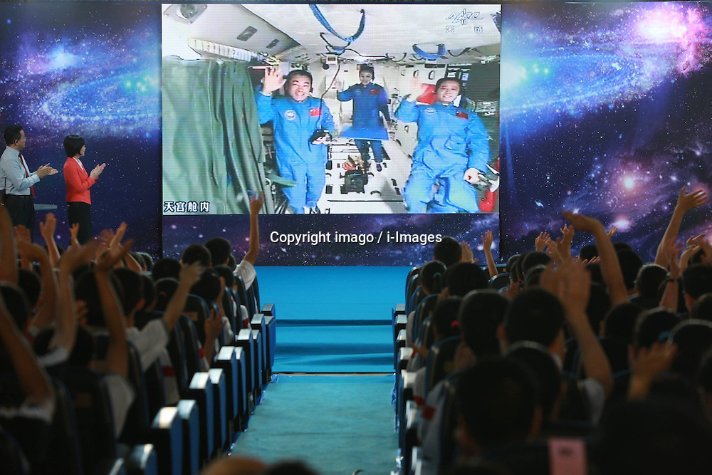 59870563  <br /> Students wave goodbye to the three crew members of Shenzhou-10 spacecraft after the space lecture, at the High School Affiliated to Renmin University of China, in Beijing, capital of China, June 20, 2013. A special lecture began Thursday morning, given by a teacher aboard China s space module Tiangong-1 to students on Earth, Thursday June 20, 2013.<br /> UK ONLY