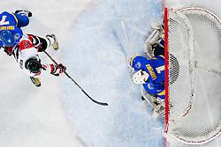 Shuhei Kuji of Japan vs Igor Karpenko of Ukraine during ice-hockey match between Japan and Ukraine at IIHF World Championship DIV. I Group A Slovenia 2012, on April 21, 2012 at SRC Stozice, Ljubljana, Slovenia. (Photo By Matic Klansek Velej / Sportida.com)