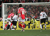 Photo: Lee Earle.<br /> Benfica v Liverpool. UEFA Champions League. 2nd Round, 1st Leg. 21/02/2006. Benfica's Luisao (L) beats Jose Reina to score.