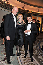 Trainer JOHN GOSDEN, his wife RACHEL and jockey WILLIAM BUICK at the 21st Cartier Racing Awards held at The Dorchester, Park Lane, London on 15th November 2011.