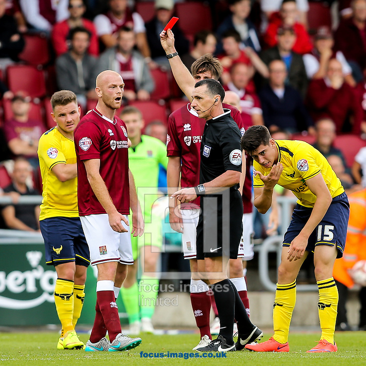 Jason Taylor of Northampton Town (2nd left) receives a red card from referee Neil Swarbrick for alledgedly using an elbow on Callum O'Dowda of Oxford United (right)  during the Sky Bet League 2 match at Sixfields Stadium, Northampton<br /> Picture by Andy Kearns/Focus Images Ltd 0781 864 4264<br /> 12/09/2015
