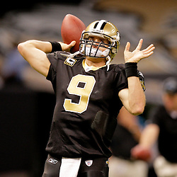Nov 08, 2009; New Orleans, LA, USA;  New Orleans Saints quarterback Drew Brees (9) throws in warm ups prior to kickoff against the Carolina Panthers at the Louisiana Superdome. Mandatory Credit: Derick E. Hingle