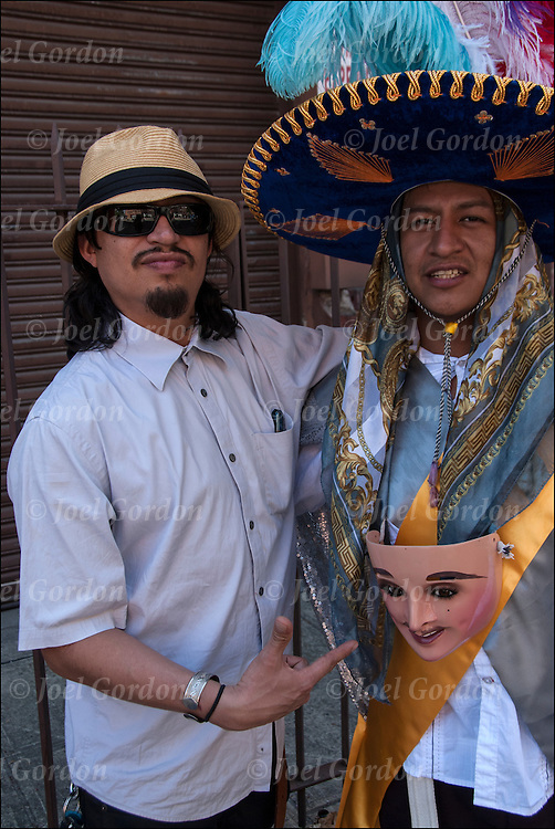 Portrait of modern and traditional brothers showing  their ethnic pride on Mothers Day at block party in West Village off 9th Avenue in New York City,<br />