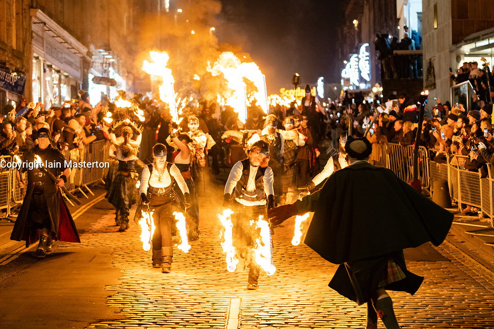 Edinburgh 's Hogmanay Torchlight Procession along the historic Royal Mile in the Old Town and ending at Holyrood Park, Scotland, UK
