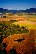 Cairns, Queensland, AUS, 20070917: A plane prepares to land at the airport in Cairns.<br /> Aviation yields GHG emissions that have the potential to influence global climate. In the United States alone, aviation makes up about 3 percent of the national GHG inventory and about 12 percent of transportation emissions.