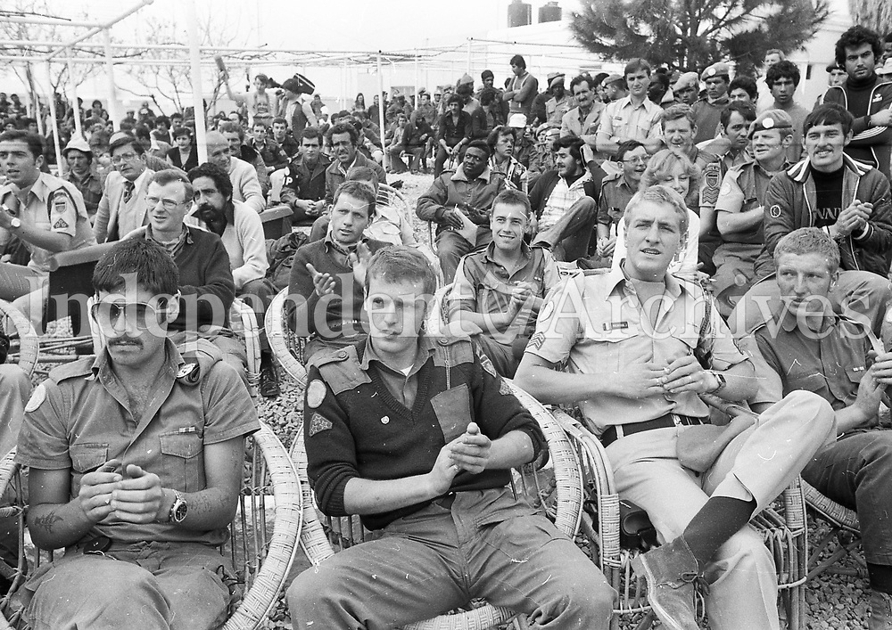 Soldiers from all contingents enjoying one of Geraldine Branagan's concerts whilst visiting Irish troops in the Lebanon.  March 14, 1980. (Part of the Independent Newspapers/NLI Collection)