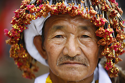 May 10, 2017 - Lalitpur, Nepal - A Nepalese man dressed in traditional attire looks on during celebrations of Ubhauli festival in Lalitpur, Nepal on Wednesday, May 10, 2017. The festival of Ubhauli marks the beginning of the farming season and the arrival of summer for better health and crops and is one of the biggest festivals celebrated by Kirat religion in Nepal. (Credit Image: © Skanda Gautam via ZUMA Wire)