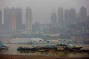 Pleasure cruisers from Victoria Line awaiting Western passengers for Yangtze River cruise, Chongqing, China