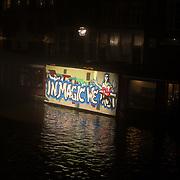 NLD/Amsterdam/20171221 - Netflix verlicht Amsterdam voor de film Bright, Graffiti naar aanleiding van de film Bright
