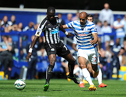 Queens Park Rangers' Karl Henry jostles for the ball with Newcastle United's Moussa Sissoko - Photo mandatory by-line: Dougie Allward/JMP - Mobile: 07966 386802 - 16/05/2015 - SPORT - football - London - Loftus Road - QPR v Newcastle United - Barclays Premier League