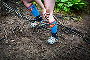 A junior racer wears superman socks.