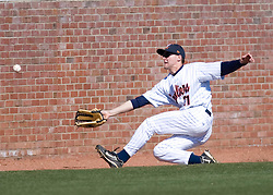 Virginia Cavaliers LHP/OF Dan Grovatt (21) dives into a brick wall trying to catch a foul ball.  The #16 ranked Virginia Cavaliers baseball team defeated the Cornell Big Red 12-2 at the University of Virginia's Davenport Field in Charlottesville, VA on March 1, 2008.