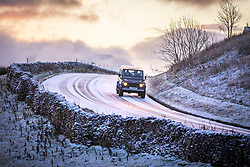 © Licensed to London News Pictures. 25/11/2017. Gearstones UK. A Landrover travels along the Newby Head pass in Gearstones this morning after a night of snow fall in the Yorkshire Dales. Photo credit: Andrew McCaren/LNP