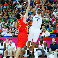 08 August 2012: France Tony Parker takes a jumpshot over Rudy Fernandez during 66-59 Team Spain victory over Team France, during the men's basketball quarter-finals, at the 02 Arena, in London, Great Britain.