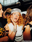 Claire from Manumission, wearing a sailor hat and diamante bracelet Ibiza 2001