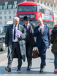 © Licensed to London News Pictures . 27/03/2017 . London , UK . PATRICK O'FLYNN , GAWAIN TOWLER and PAUL NUTTALL cross north over Westminster Bridge in London . Photo credit: Joel Goodman/LNP