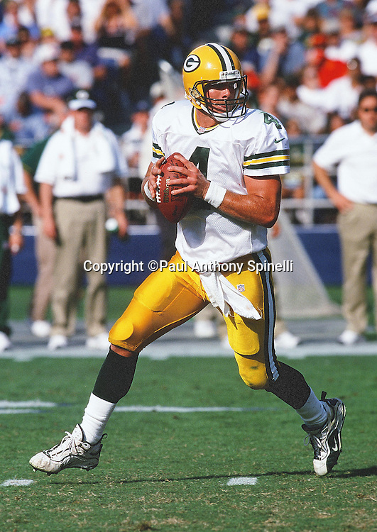 Green Bay Packers quarterback Brett Favre (4) scrambles as he looks to pass during the NFL football game against the San Diego Chargers on Oct. 24, 1999 in San Diego. The Packers won the game 31-3. (©Paul Anthony Spinelli)