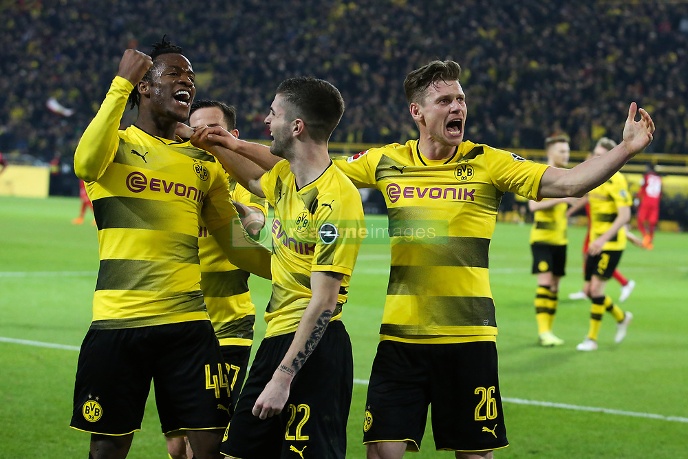 DORTMUND, March 12, 2018  Michy Batshuayi (1st L) of Dortmund celebrates with his teammates during the German Bundesliga soccer match between Borussia Dortmund and Eintracht Frankfurt in Dortmund, Germany, on March 11, 2018. Dortmund won 3-2. (Credit Image: © Joachim Bywaletz/Xinhua via ZUMA Wire)