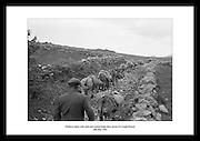Esler, ladde med sand og sement begnner deres bestigelse av Croagh Patrick (The Reek), 1962..Fjellet er i senere tid blitt et populært sted for pilegrimer, grunnet en legende om St. Patrick.