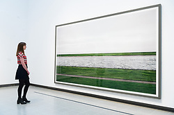 © Licensed to London News Pictures. 24/01/2018. London, UK. Photograph titled Rhine III, 1999/2015, by artist ANDREAS GURSKY is on display as part the first major UK retrospective of the German photographer. The showcase also marks the Haywood galleries 50th anniversary following its two year refurbishment. Photo credit: Ray Tang/LNP