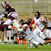 Mississippi defensive back Cody Prewitt (25) trips up Texas A&M tight end Cameron Clear (85) during the first half of an NCAA college football game in College Station, Texas, Saturday, Oct. 11, 2014. (Photo/Thomas Graning)
