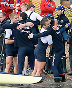 Putney, GREAT BRITAIN,  Oxford celebrate victory after winning the  in 2009 Boat Race.  Raced over the 'Championship Course' Putney to Mortlake, on the River Thames, Sun.29.03.2009. [Mandatory Credit, Peter Spurrier / Intersport-images]..Oxford Crew, Bow, Michal PLOTKOWIAK, Colin SMITH, Alex HEARNE, Ben HARRISON, Sjoerd HAMBURGER, Tom SOLESBURY, George BRIDGEWATER, Ante KUSURIN and cox Colin GROSHONG. . Rowing Course: River Thames, Championship course, Putney to Mortlake 4.25 Miles,