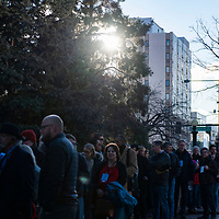 The sun shines through trees as spectators wait to enter the first Democratic presidential campaign rally for former Colorado Governor John Hickenlooper, held at the Greek Amphitheater in Denver's Civic Center Park on Thursday, March 7, 2019. Photo by Andy Colwell, special to the Colorado Sun