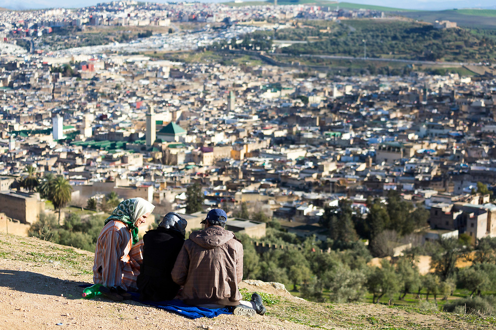 Fez, Morocco - 3rd FEBRUARY 2018 - Friends sit and admire a view over the old Fez Medina, Middle Atlas Mountains, Morocco.