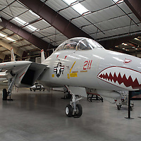"""Made famous by the movie """"Top Gun,"""" the F-14 Tomcat is the last of Grumman's """"Cat"""" series of Naval fighters which began with the F4F Wildcat in the 1930s. The F-14 grew out of the failed attempt to turn the F-111 into a carrier-based interceptor. Design work on the Tomcat began in 1967, a full year before the F-111B was canceled. It adopted the best elements of that design including the AN/AWG-9 radar and Phoenix missile, twin engines, and a variable geometry """"swing"""" wing and combined them into a large, twin-tailed form that became the symbol of American naval aviation from the 1970s through the first years of the Twenty-first Century. Tomcats entered service on the USS Enterprise in 1974, and flew some of the last American combat missions over Vietnam while providing air cover over Saigon during the American evacuation in April 1975. The Tomcat was retired from service in the U.S. Navy in 2006.<br /> <br /> Specifications<br /> <br />     Wingspan: 64 ft 1 in<br />     Length: 62 ft 8 in<br />     Height: 16 ft<br />     Weight: 59,714 lbs (loaded)<br />     Max. Speed: 1,544 mph<br />     Service Ceiling: 55,000 ft<br />     Range: 2,400<br />     Engines: 2 Pratt & Whitney TF30-P-414A turbofans with 20,900 pounds of thrust<br />     Crew: 2<br /> <br /> Description via pimaair.org"""