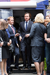 © Licensed to London News Pictures. 23/06/2015. London, UK. DAVID CAMERON leaving the bus at the launch of the Start-Up Britain campaign routemaster bus in Downing Street, London with Prime Minister, David Cameron. Over five weeks the routemaster bus will visit 30 towns and cities - including Aberdeen, Inverness, Swansea York and Leeds - and aim to engage with 15,000 individuals through workshops and networking events, making them aware of the assistance Start-Up Britain can offer. Photo credit : Vickie Flores/LNP