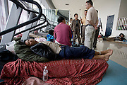 Earthquake refugees sleep in treadmills at a camp in the sports stadium in Mianyang, China