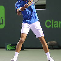 Novak Djokovic, of Serbia, returns a shot from Martin Klizan, of Slovakia,  during their match at the Miami Open tennis tournament on Saturday, March 28, 2015 in Key Biscayne, Florida. Djokovic defeated Klizan 6-0, 5-7, 6-1. (AP Photo/Alex Menendez)